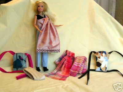 Barbie y su colección de Portabebés